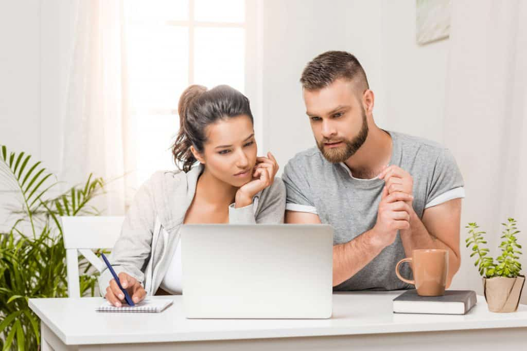 Couple on laptop and desk