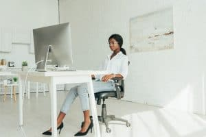 Woman on laptop white office