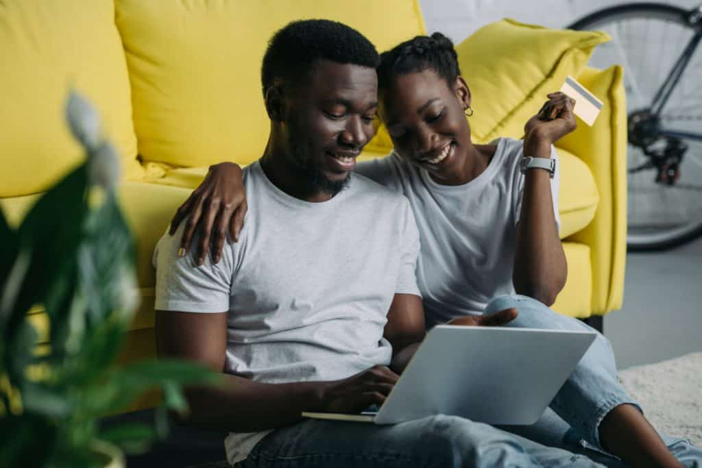 Young couple on laptop with credit card